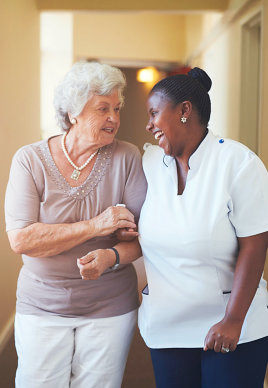 caregiver assisting her elderly patient