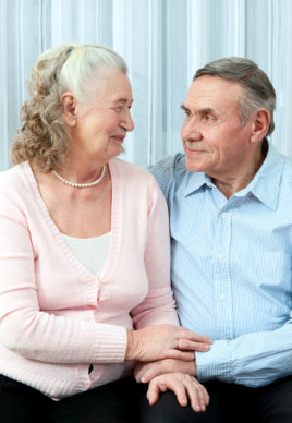 elderly couple looking each other