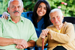 elderly couple and their caregiver