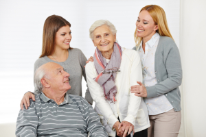 elderly couple and caregivers